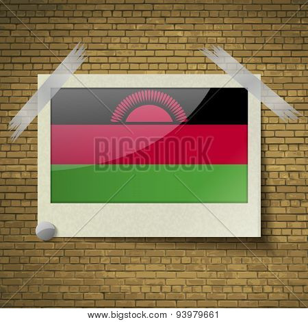 Flags Malawi At Frame On A Brick Background. Vector