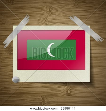 Flags Maldives At Frame On Wooden Texture. Vector
