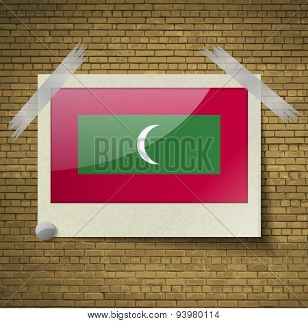 Flags Maldives At Frame On A Brick Background. Vector
