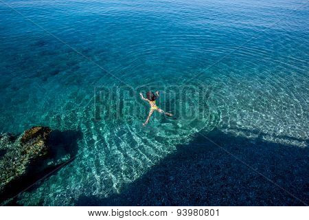Woman swimming in the sea