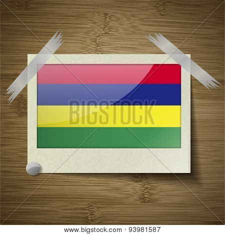 Flags Mauritius At Frame On Wooden Texture. Vector