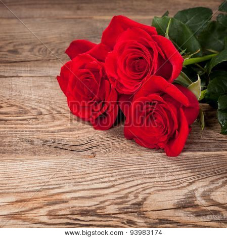Beautiful Red Roses On The Old Board