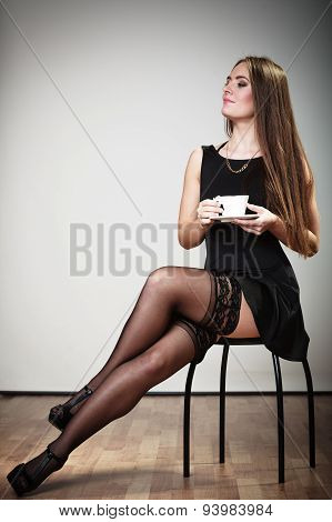 Cheerful Woman Drinking Coffee