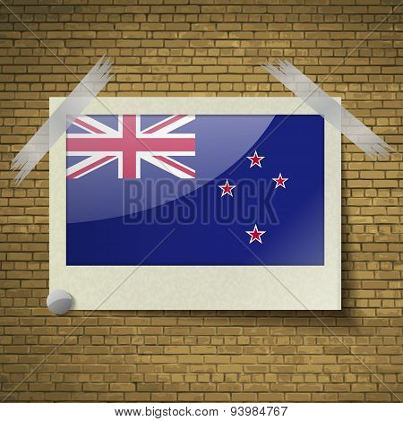 Flags New Zelandat Frame On A Brick Background. Vector