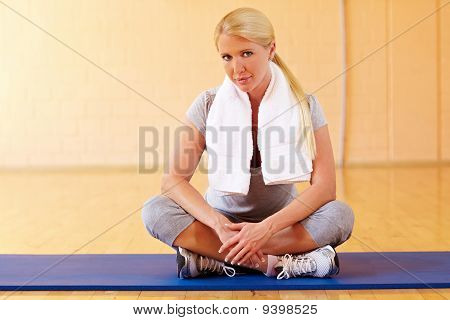 Woman Taking Break In Gym