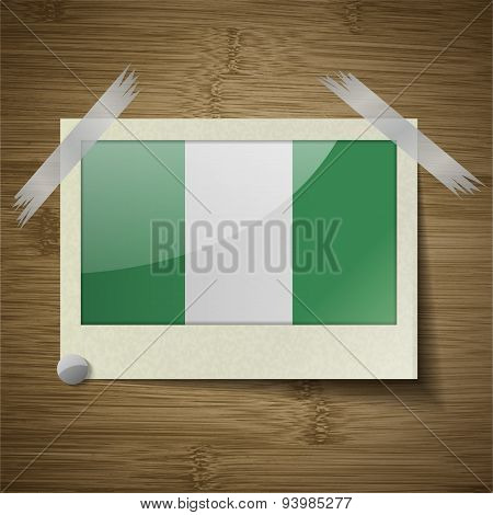 Flags Nigeria At Frame On Wooden Texture. Vector
