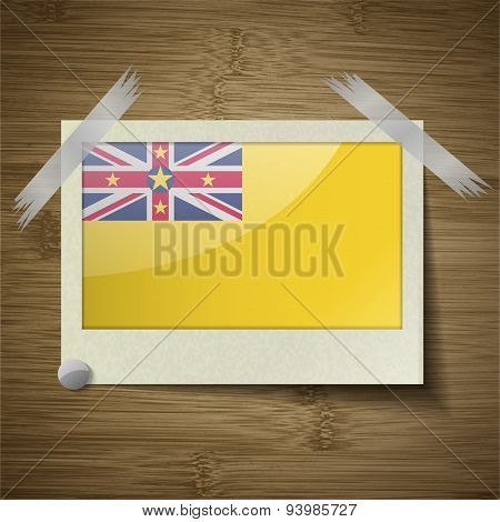 Flags Niue At Frame On Wooden Texture. Vector