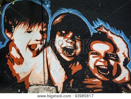 MOSCOW - JUNE 21, 2015: Graffiti on a urban wall (near B. Novodmitrovskaya street). Happy children.