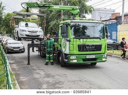 MOSCOW - JUNE 21, 2015: Tow truck at the city street.