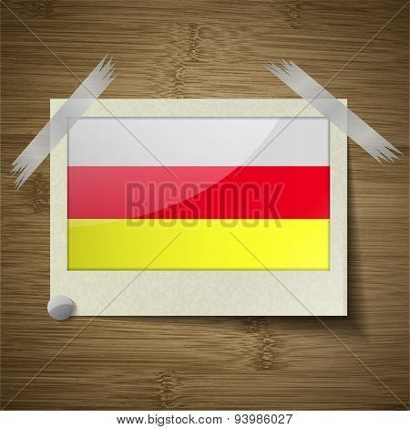 Flags North Ossetia At Frame On Wooden Texture. Vector
