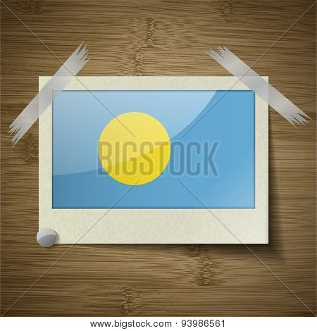 Flags Palau At Frame On Wooden Texture. Vector
