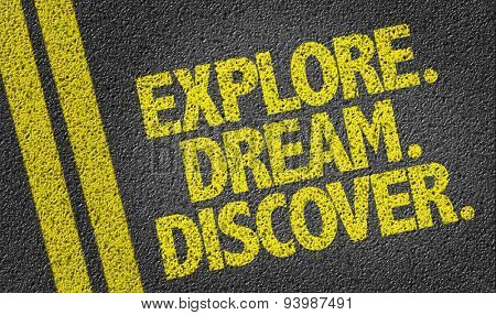 Explore. Dream. Discover. written on the road