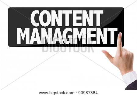 Businessman pressing button with the text: Content Management