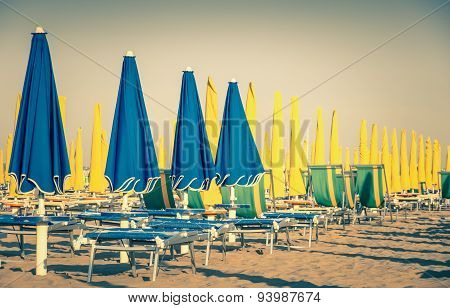 Umbrellas And Sunbeds At Rimini Beach Italy - Vintage Retro Nostalgic Filtered Look
