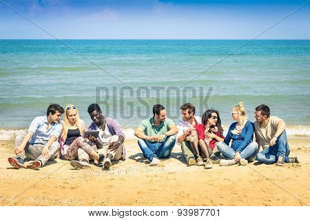 Group Of Multiracial Best Friends Sitting At Beach Talking With Each Other - Summer Concept