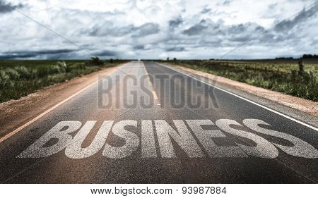 Business written on rural road