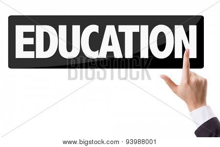 Businessman pressing button with the text: Education