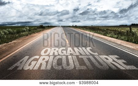 Organic Agriculture written on rural road