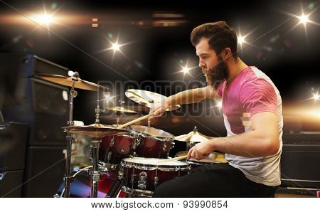 music, people, musical instruments and entertainment concept - male musician playing cymbals at rock concert