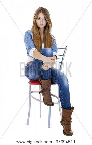 Portrait in full growth the young girl in a jacket and blue jeans, isolated on white