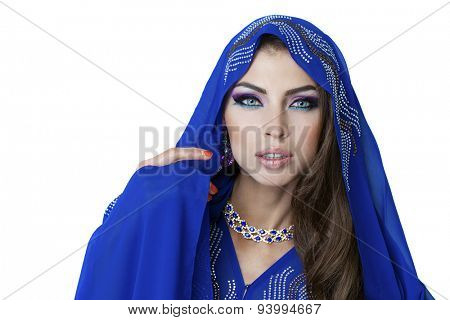 Young traditional Asian Indian woman in indian blue sari, isolated on white background