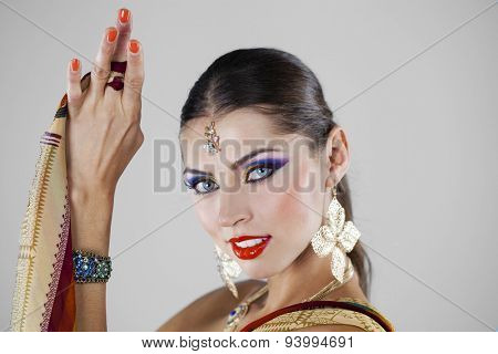 Young beautiful brunette woman in indian dress