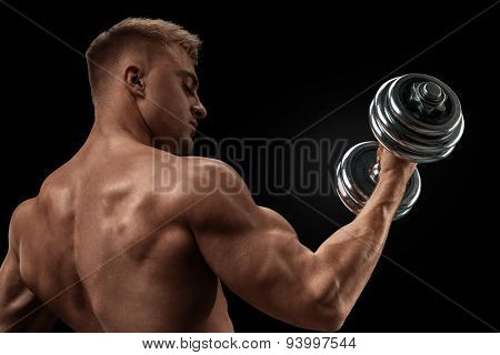Handsome Athletic Man Working Out With Dumbbells