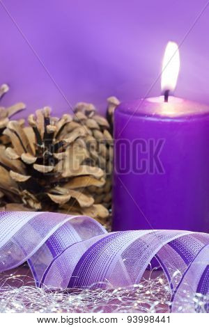 burning candle and gift ribbon