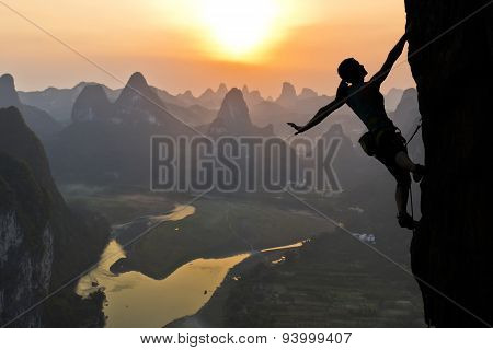Female climber silhouette in Chinese landscape
