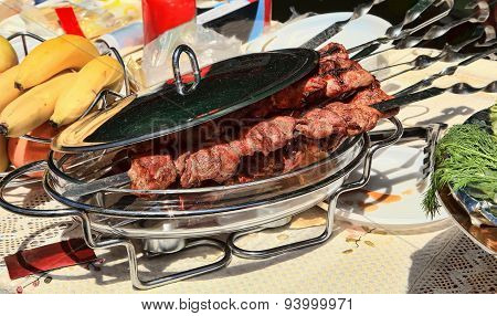 The Caucasian Shish Kebab On Skewers In A Dish With A Lid For A Barbecue. Selective Focus.