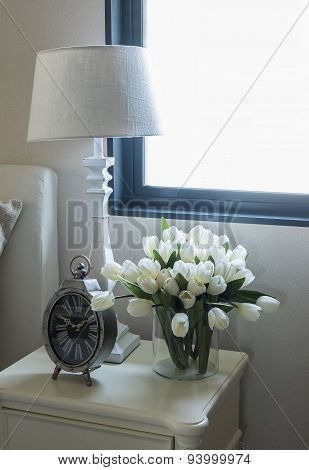White Lamp And Alarm Clock On Bedside Table