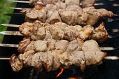 image of brazier  - The shish kebab on skewers is fried on a brazier - JPG