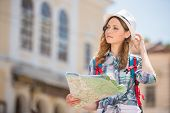 picture of european  - Woman lost in old european city holding a map - JPG