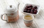 picture of teapot  - fresh healthy hot tea in a teapot and cup whit cherries - JPG