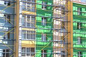 foto of scaffold  - scaffolding for exterior decoration of a multistory building - JPG