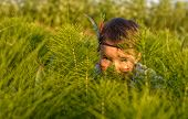 pic of indian chief  - funny little girl as indian hiding behind grass - JPG