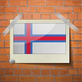 pic of faro  - Flags of Faroe Islands scotch taped to a red brick wall - JPG