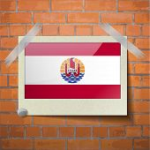 stock photo of french polynesia  - Flags of french polynesia scotch taped to a red brick wall - JPG