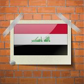 image of iraq  - Flags of Iraq scotch taped to a red brick wall - JPG