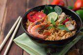 foto of thai cuisine  - Tom Yum Kung with noodles is popular Thai dish cuisine - JPG