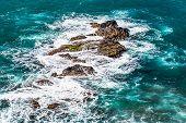 picture of atlantic ocean  - Stones in waves of ocean on shore of Atlantic ocean in Tenerife Canary island Spain at spring or summer  - JPG