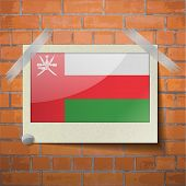 foto of oman  - Flags of Oman scotch taped to a red brick wall - JPG