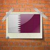 stock photo of qatar  - Flags of Qatar scotch taped to a red brick wall - JPG