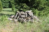 stock photo of landfills  - Landfill stones among green grass - JPG