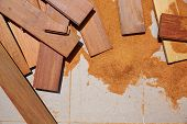 stock photo of wood pieces  - Carpenter sawdust and decking pieces after ipe wood deck work - JPG