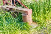 foto of splayed  - Tractor mounted rotary mower during operation closeup - JPG
