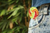 foto of texans  - colorful of candy in a jeans pocket - JPG