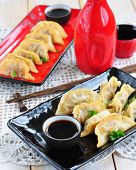 stock photo of soy sauce  - Fried asian wonton with soy sauce - JPG
