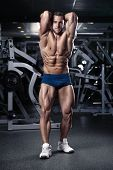 image of hamstring  - Strong Athletic Man Fitness Model Torso showing muscles in gym - JPG