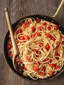 image of cooked crab  - close up of rustic spicy italian crab and cherry tomato spaghetti pasta - JPG